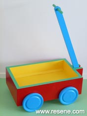 Paint a wooden toy cart.