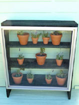 Make a mini glasshouse from a window and fene palings