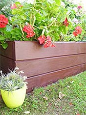 Paint a raised garden bed.