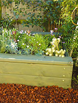 Make a raised bed planter with built in seat