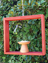 Wooden hanging bird feeder