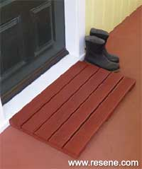 an all weather doormat using grooved decking