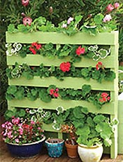 how to turn an old wooden pallet into a nifty e saving upright planter