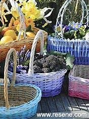 Paint wicker baskets in your favourite colours