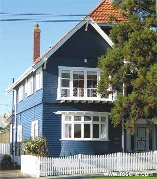 Exterior weatherboards finished in Resene Sonyx 101 CoolColour in a deep blue