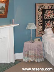 A guest bedroom painted with Resene Tax Break which is a vibrant Prussian blue