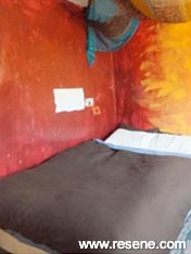 Hand painted art work features in this bedroom