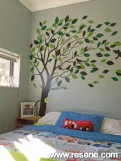 Resene Periglacial Blue with a painted tree mural