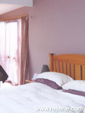 a bedroom with light trims and colourful walls