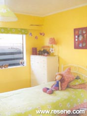 A soft Resene yellow and Resene Lipstick pink warm a girl's bedroom