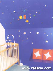 Childs bedroom with resene magnetic paint coloured Resene Deep Koamaru with silver Aluminium stars