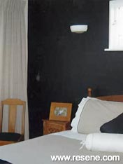 Bedroom with a painted feature wall