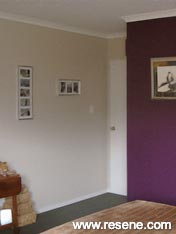 Bedroom with a feature wall in Resene Plum