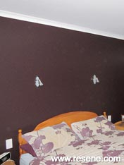 Bedroom with feature wall of Resene Double Caffeine