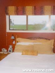 Resene Tamarillo and Resene Spanish White bedroom