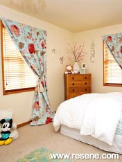 A pretty bedroom design, filled with rounded shapes and pleasing curves
