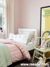A pink bedroom need not be filled with ruffles and lace