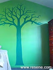 Wall mural of a tree in a boy's room