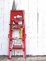 Convert an old wooden ladder to nifty shelves