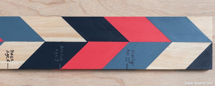 Paint an age record stick with stripes